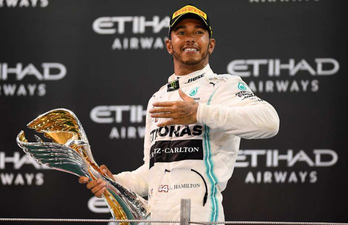F1 World Champion Lewis Hamilton has once again turned away the rumours of joining the Ferrari saying he is already happy with Mercedes.