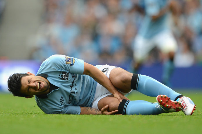 Manchester City striker Sergio Aguero will fly to Barcelona to have a specialist look at his knee after he picked up an injury on Monday, the club said.