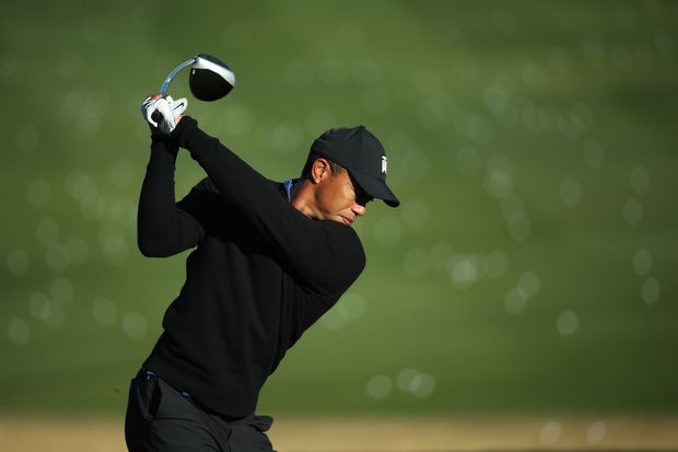 Tiger Woods said the absence of an adoring and raucous crowd at the PGA Championship on Thursday was part of the