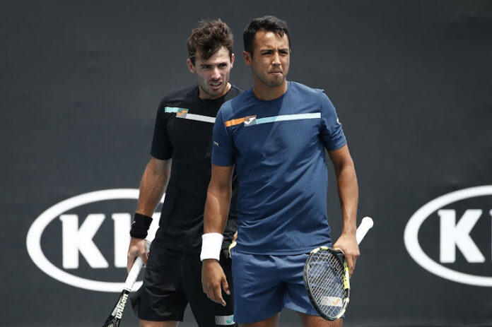 The participation of Guido Pella and Hugo Dellien in the US Open is in doubt after physio was the only person out of 1,400 to test positive for Covid-19.