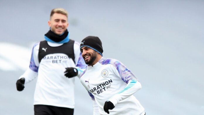 Manchester City winger Riyad Mahrez and defender Aymeric Laporte have tested positive for Covid-19, the club has announced.