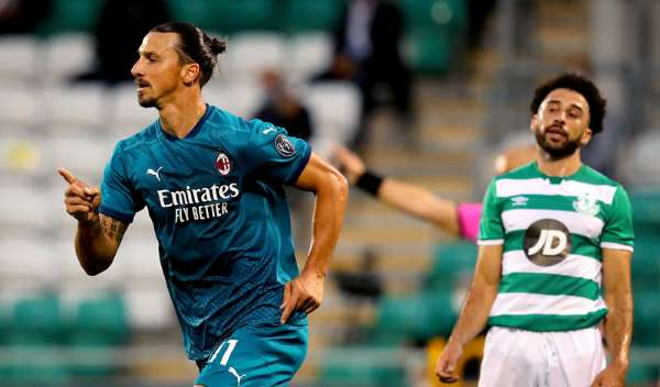 Goals from Zlatan Ibrahimovic and Hakan Calhanoglu saw AC Milan beat League of Ireland side Shamrock Rovers in their Europa League qualifier in Dublin.