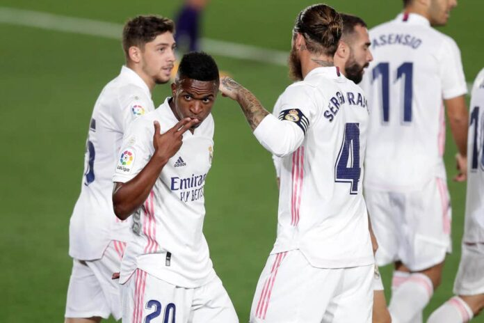 Reigning champions Real Madrid continued their unbeaten start in La Liga as goals from Vinicius Junior and Karim Benzema saw off Levante.