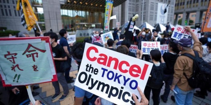 Tokyo New Virus Cases Close 2,000 A Day Before Olympics Open - SportRazzi